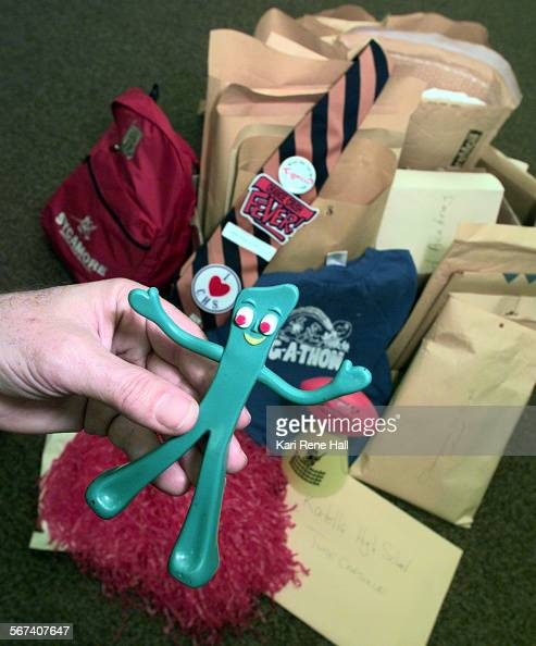 MECapsulegumbyD101598KRH––John Holland publicity director for Anaheim Union High School District holds a Gumby toy that was among the items including...