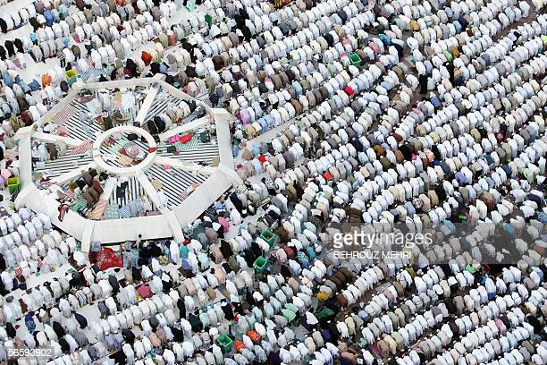 Muslim pilgrims perform the afternoon prayers at the courtyard of the Grand Mosque in the holy city of Mecca 14 January 2006 Grieving loved ones...