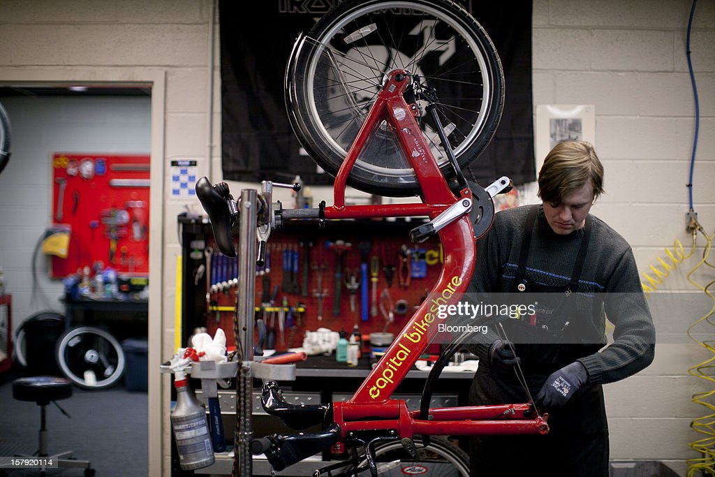 Mechanic Brendan Gilmour makes repairs to a Capital Bikeshare bicycle in Washington, D.C., U.S., on Friday, Nov. 30, 2012. Since Sept. 2010, Capital Bikeshare has dispersed more than 1700 bikes for rent across the city and has totaled over 3.5 million rides since Sept. 2011. Alta Bicycle Share, the company that was awarded the contract to run the program, has installed 191 solar-powered docking stations throughout the District and Arlington, Virginia. Photographer: Andrew Harrer/Bloomberg via Getty Images
