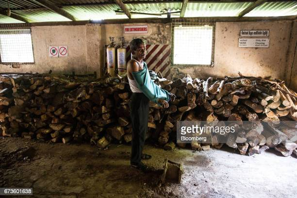 A mechanic changes before work at the factory of the Geragama Tea Estate operated by Pussellawa Plantations Ltd in Pilimathalawa Central Sri Lanka on...