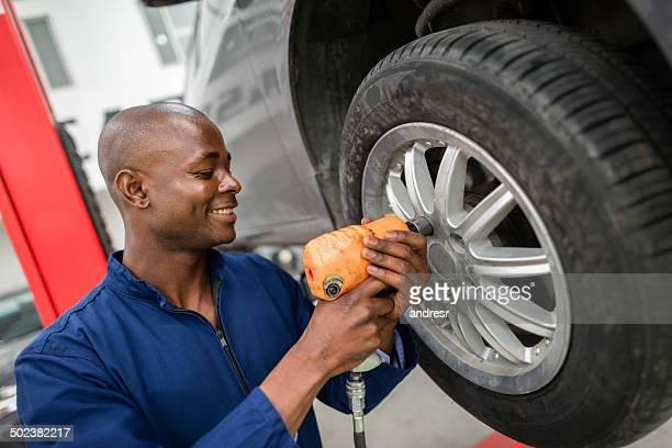 Mechanic changing a wheel