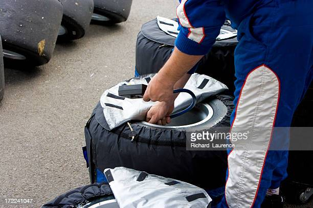 Mechanic checking racing tyres