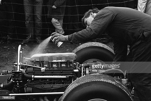 BRM mechanic coaxes a Formula One engine to life with help of an ether mix spray on October 2 1966 at US Grand Prix at Watkins Glen New York
