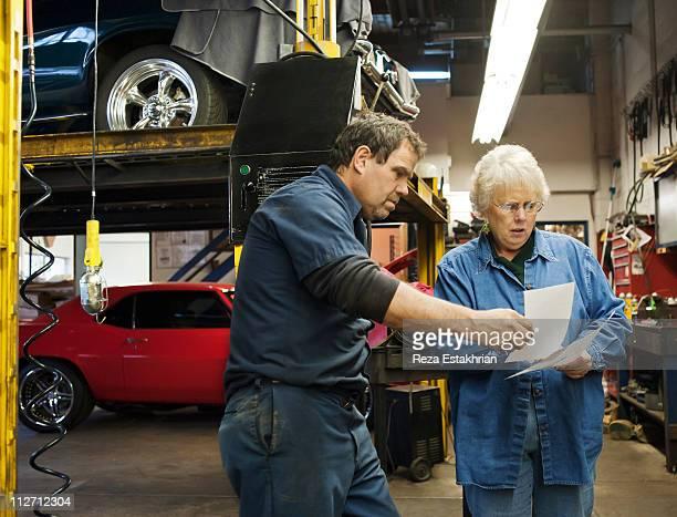 Mechanic discusses invoices