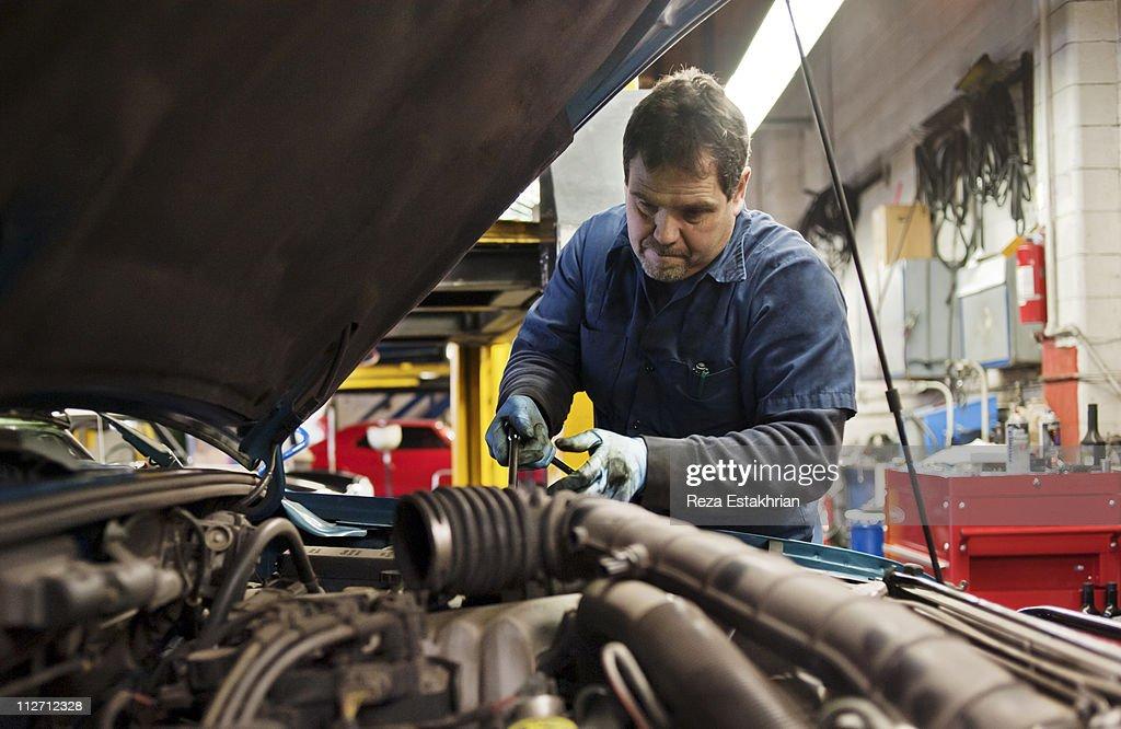 Mechanic fixes engine
