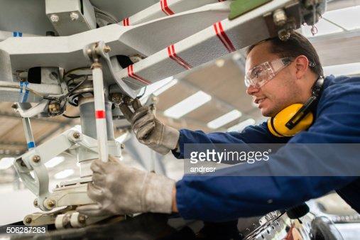 Mechanic fixing a propeller