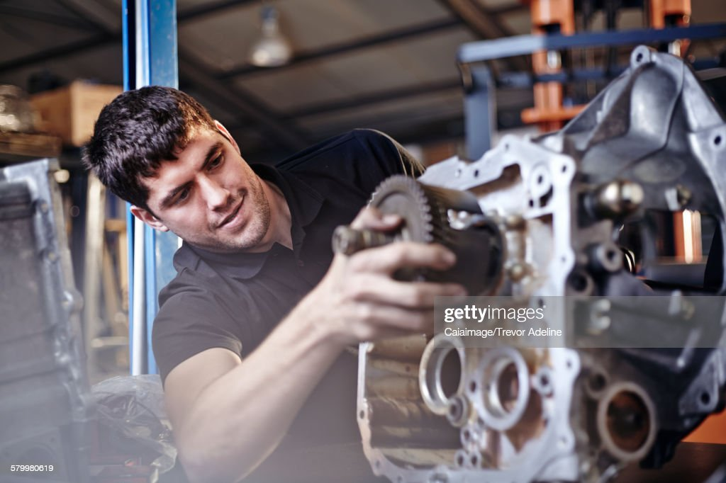 Mechanic fixing part in auto repair shop