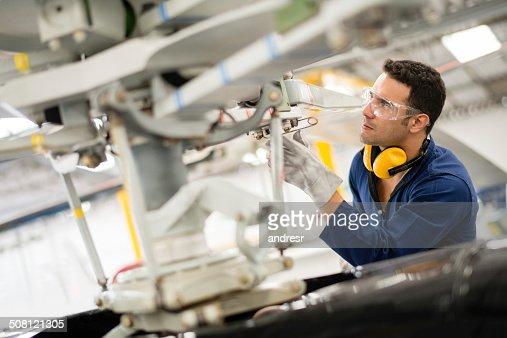 Mechanic fixing the propeller