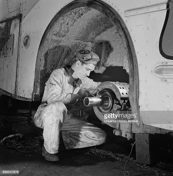 Mechanic Fixing Wheel Axle of Greyhound Bus at Garage Knoxville Tennessee USA Esther Bubley for Office of War Information September 1943