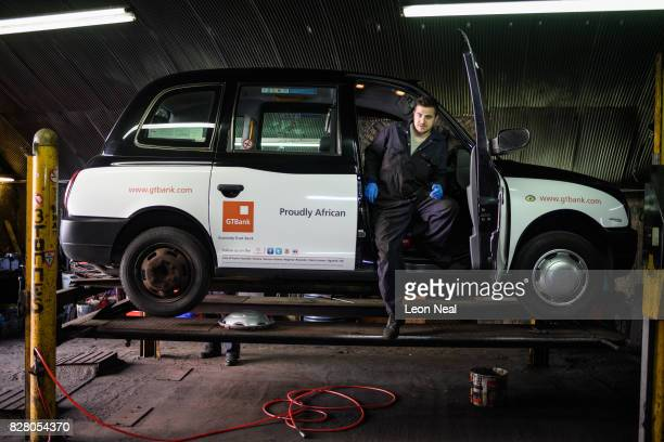 Mechanic Fred Prescott carries out repair work on a traditional London taxi at Bow Taxi Repairs on August 8 2017 in London England Mayor of London...