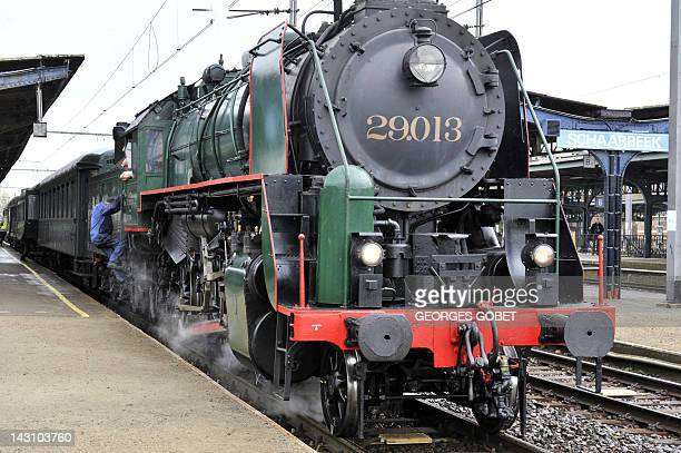 A mechanic gets into Belgian 1940s locomotive on April 18 2012 at The Gare du Midi in Brussels on the occasion of the presentation of a cartoon of a...