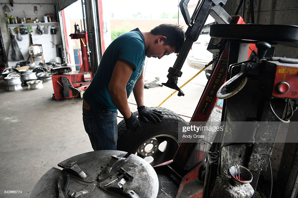Mechanic Harry Gutierrez fixes a flat tire at the Los Primos Tire Shop near Peoria and Colfax June 24, 2016.
