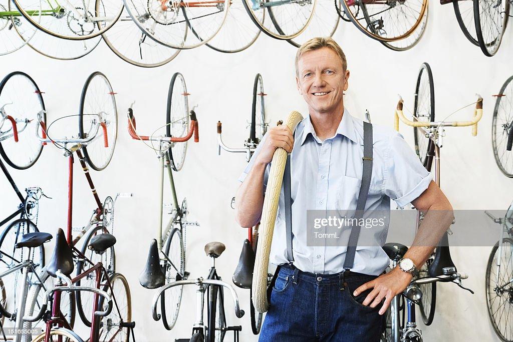 Mechanic in a Bike Store : Stock Photo