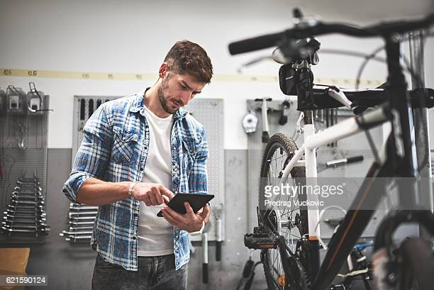 Mechanic in bicycle shop