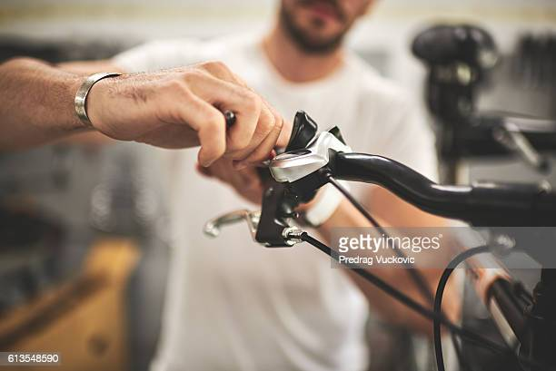 Mechanic in bicycle store