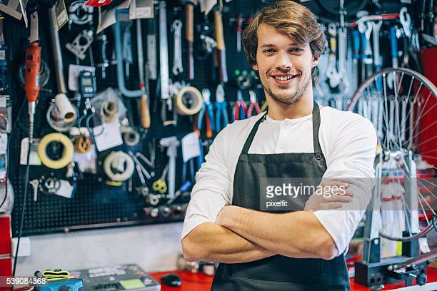 Mechanic in front of a tool board