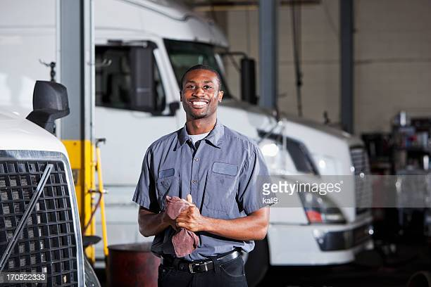 Mechanic in garage with semi-truck