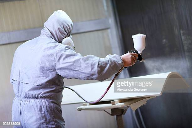 Mechanic in Painting Booth Spray Wooden Part of Furniture