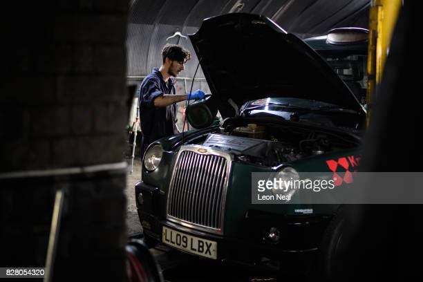 Mechanic Ionut Spirdon carries out a service on a traditional London taxi at Bow Taxi Repairs on August 8 2017 in London England Mayor of London...