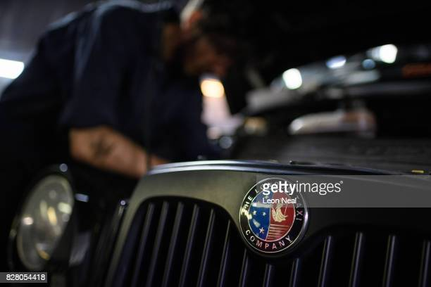 Mechanic Ionut Spirdon works on a 'London Taxi Company' taxi in the garage at Bow Taxi Repairs on August 8 2017 in London England Mayor of London...