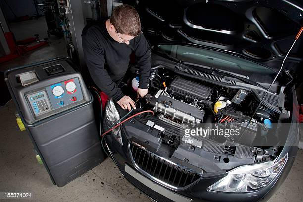 Mechanic is checking the engine of a modern car