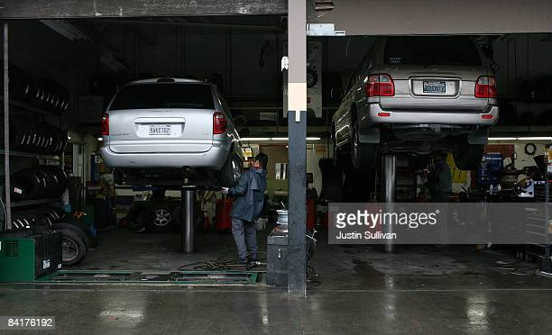 Mechanic Julio Escabedo installs a tire on a Dodge Caravan at San Rafael Firestone on January 5 2009 in San Rafael California According to a survey...