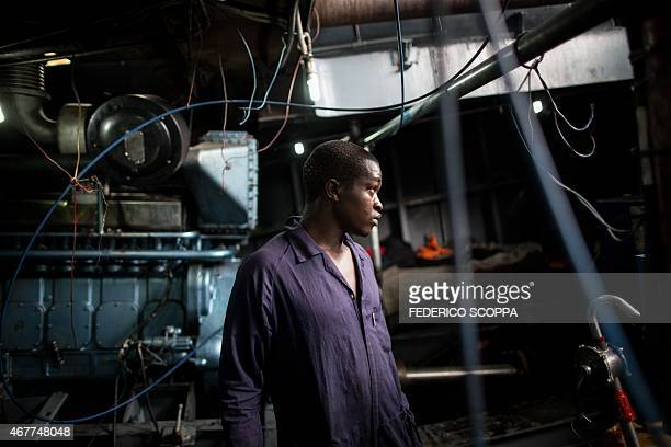 A mechanic looks on in the engine room of one of the ferries on the Kivu lake linking the two major hubs of the Kivu region Goma in the north and...
