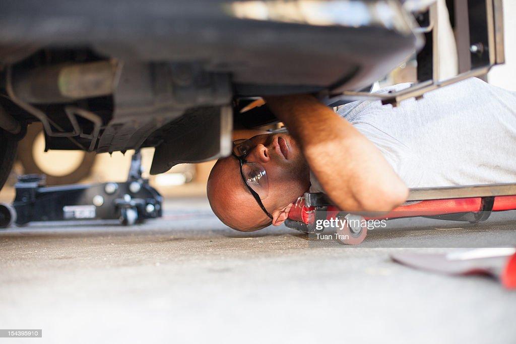 mechanic man under the car
