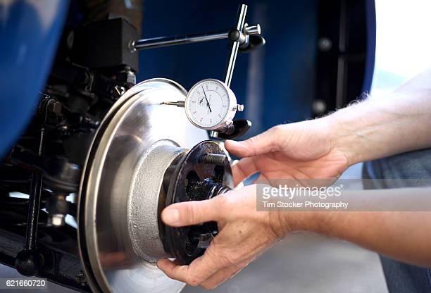Mechanic measuring Brake Discs on a classic car