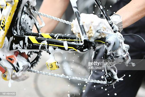 A mechanic of Kazakh cycling team Astana cleans the chain of a bicycle at Novotel hotel before a training session on July 13 2009 in Limoges on the...