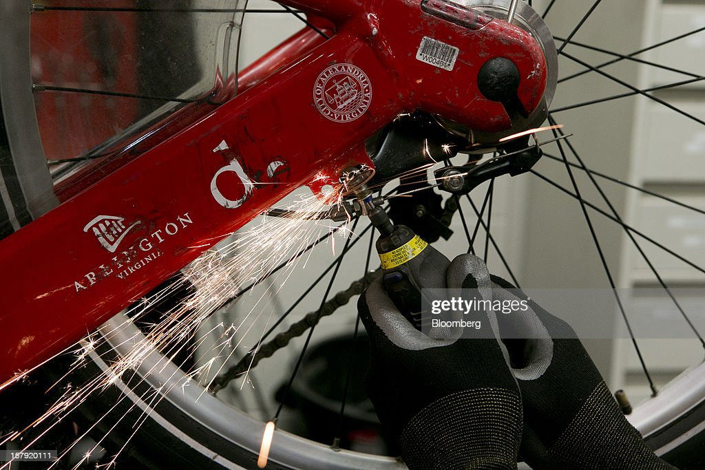 Mechanic Paul Christian makes repairs to a Capital Bikeshare bicycle in Washington, D.C., U.S., on Friday, Nov. 30, 2012. Since Sept. 2010, Capital Bikeshare has dispersed more than 1700 bikes for rent across the city and has totaled over 3.5 million rides since Sept. 2011. Alta Bicycle Share, the company that was awarded the contract to run the program, has installed 191 solar-powered docking stations throughout the District and Arlington, Virginia. Photographer: Andrew Harrer/Bloomberg via Getty Images