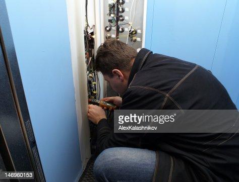 mechanic repairing button : Stock Photo