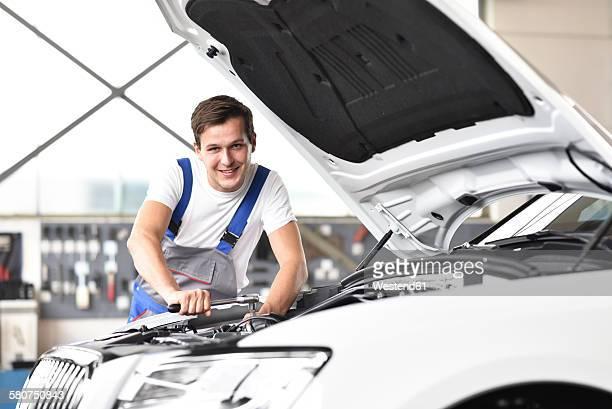 Mechanic repairing car in a garage