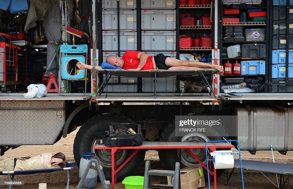 A mechanic rests on a truck during Stage 13 of the 2013 Dakar Rally between Copiapo and La Serena, in Chile, on January 18, 2013. The rally is taking place in Peru, Argentina and Chile from January 5 to 20.