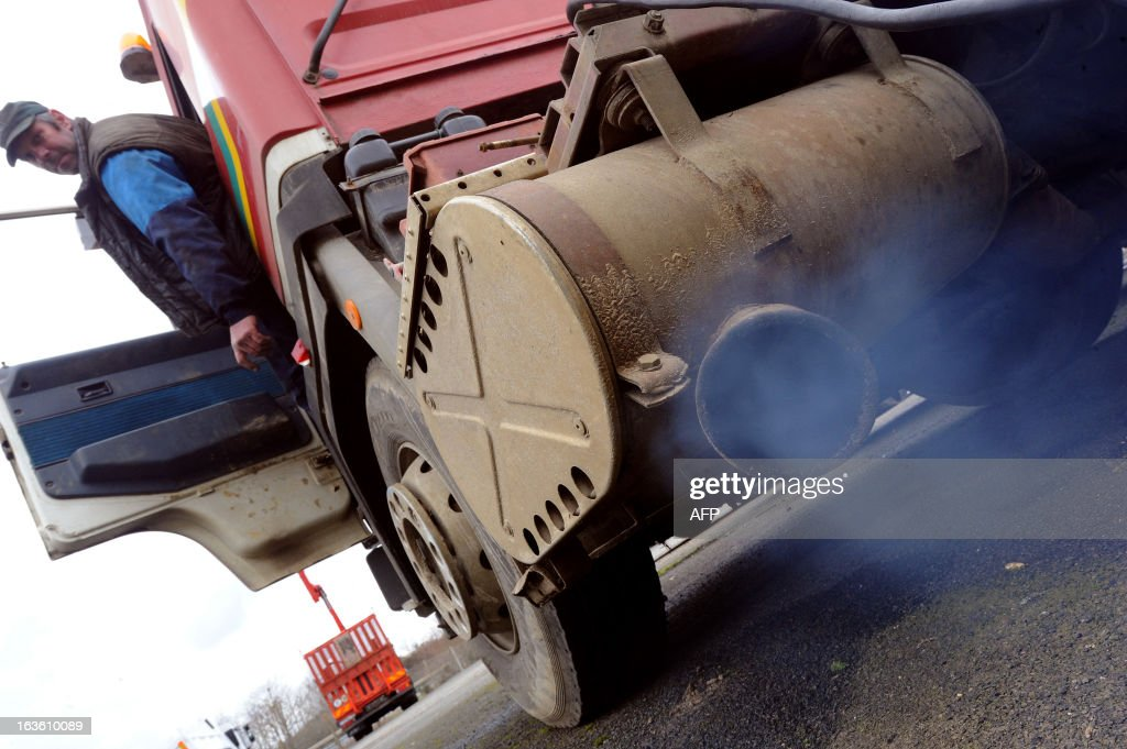 A mechanic starts a truck of 1989, with no limiting device from pollution by particulate matter, on March 13, 2013 in Spay, western France.