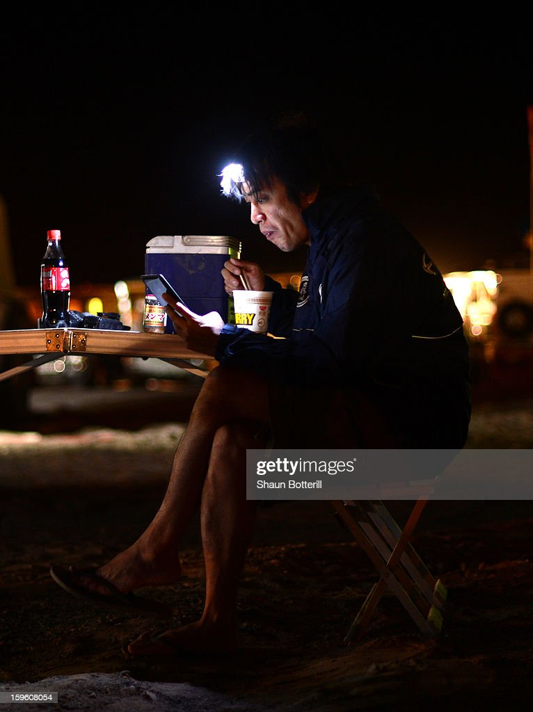 A mechanic takes a break after stage 11 from La Rioja to Fiambala during the 2013 Dakar Rally on January 16 in Fiambala, Argentina.