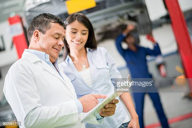 Mechanic talking to client