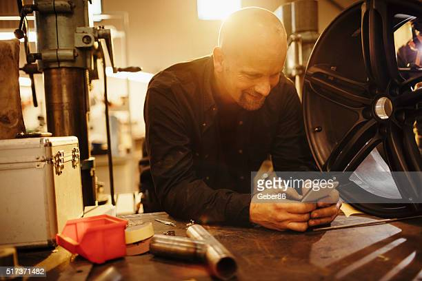 Mechanic texting while working