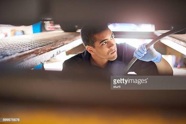 Mechanic using crow bar