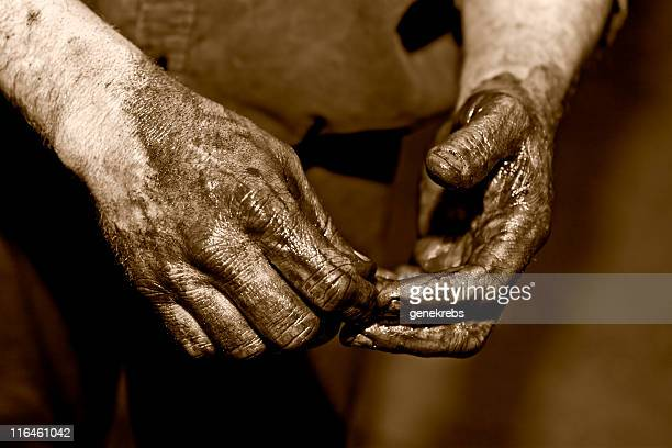 Mechanic washing Hands with solvent.