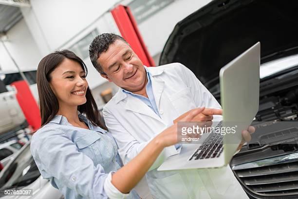 Mechanic with a customer