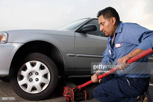 Mechanic with car and jack