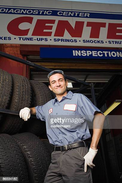 Mechanic with rack of tires