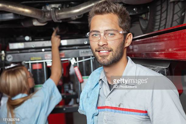 Mechanic working at his auto body shop