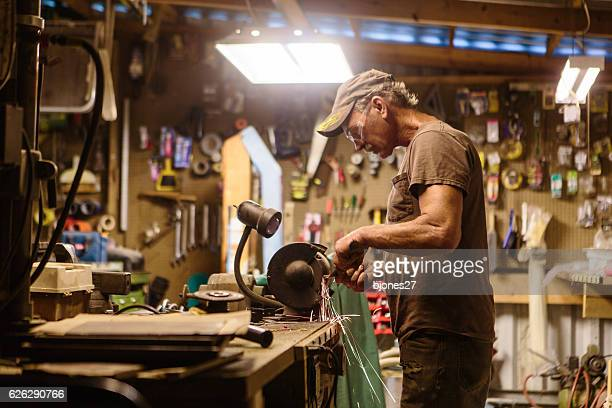 Mechanic working in garage shop