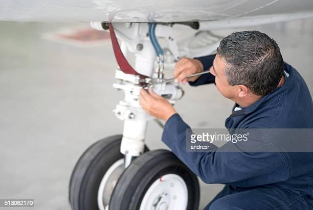 Mechanic working on an airplane