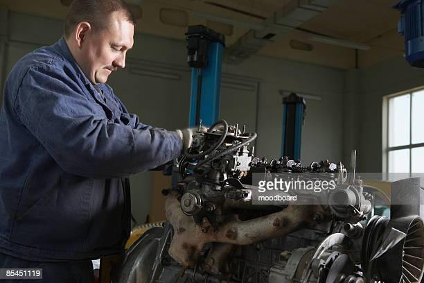 Mechanic Working on Motor
