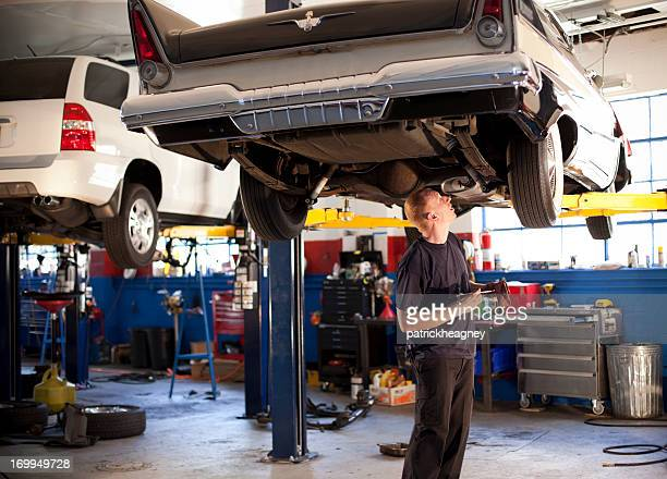 Mechanic Works on a Car