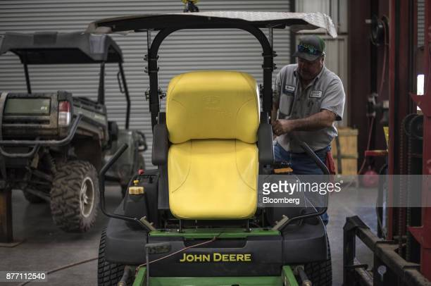 A mechanic works on a Deere Co John Deere 757 lawn mower at a United Ag Turf dealership in Waco Texas US on Monday Nov 20 2017 Deere Co is scheduled...
