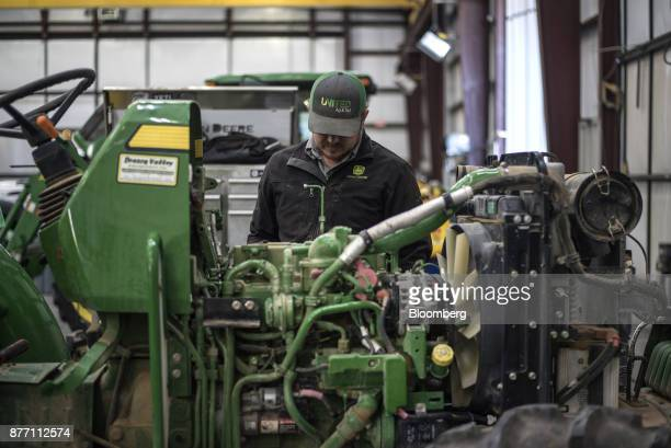 A mechanic works on a Deere Co John Deere tractor at a United Ag Turf dealership in Waco Texas US on Monday Nov 20 2017 Deere Co is scheduled to...